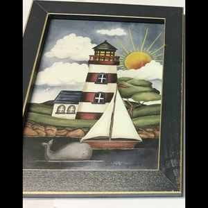 Lighthouse sailboat whale nautical picture.